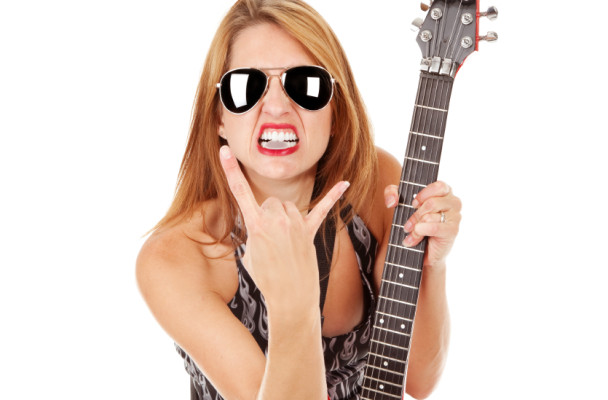 Heavy Metal Guitarist Giving Horns