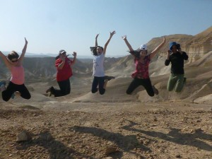 Tikkun Olam participants playing in the desert.
